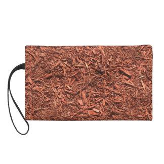 detailed mulch of red cedar for landscaper wristlet purse