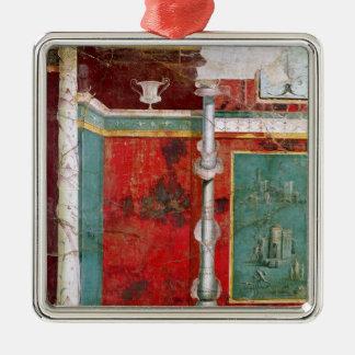 Detalle arquitectónico con un paisaje adorno navideño cuadrado de metal