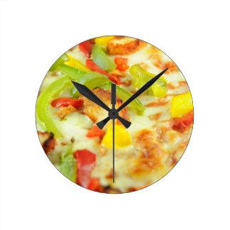 Detalle de la pizza reloj de pared