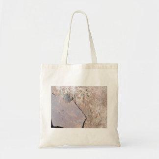 Detalle de piedra rojo de la textura bolsa