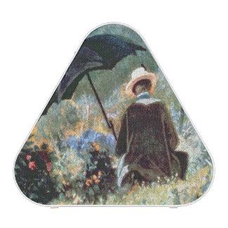 Detalle de una lectura del caballero en un jardín altavoz bluetooth