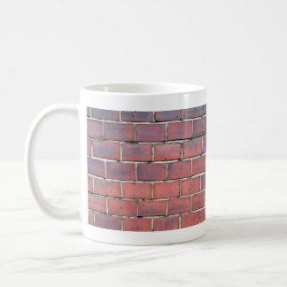 Detalle rojo liso de la pared de ladrillo tazas