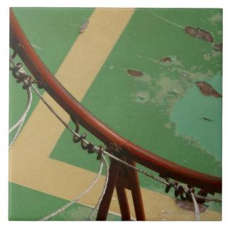 Deteriorating basketball hoop ceramic tile