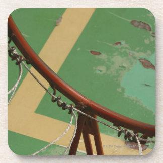 Deteriorating basketball hoop beverage coaster