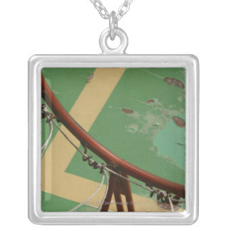 Deteriorating basketball hoop silver plated necklace