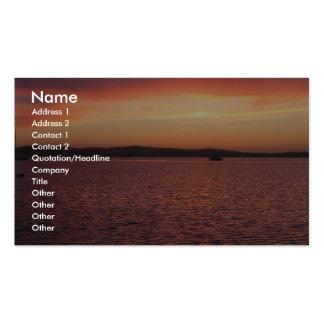 Detrás de puesta del sol roja, amarilla, y rosada  tarjetas de negocios