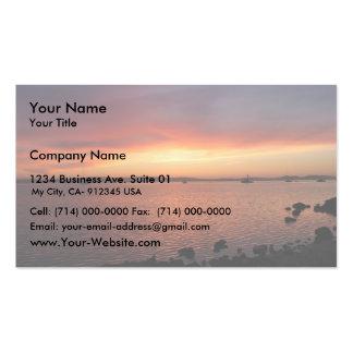 Detrás de puesta del sol roja, amarilla, y rosada  tarjetas de visita