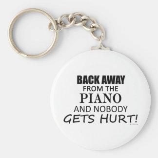 Detrás lejos del piano llaveros