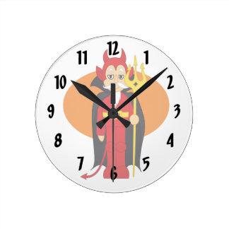 Devil Costume Orange behind Round Clocks
