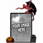 "Devil Cutout Picture Frame 5x7<br><div class=""desc"">Create a very unique Halloween decoration or centerpiece! Just upload your own image (a photo or graphic) into this frame with a devil on top, and pumpkin and gravestone below. For best results, upload an image of at least 750 x 1050 pixels (that&#39;s a 5x7 photo at 150ppi). Approximately 7&quot;...</div>"