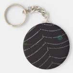 Dew-covered spider web key chain