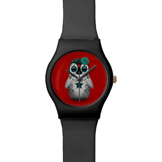 Día azul del rojo muerto del pingüino del cráneo relojes de mano