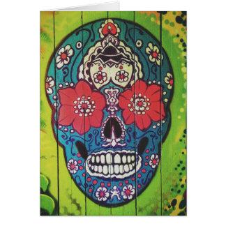 Día del cráneo azul y verde enrrollado muerto del tarjeta de felicitación