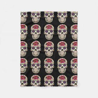 Día del cráneo muerto del azúcar con el rosa manta de forro polar