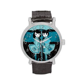 Día lluvioso en azul relojes