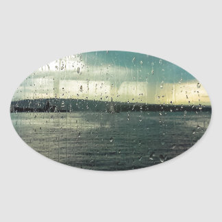 Día lluvioso pegatina ovalada
