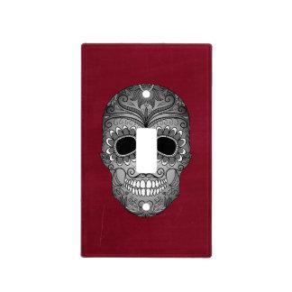 Día retro del cráneo muerto del azúcar en rojo cubierta para interruptor