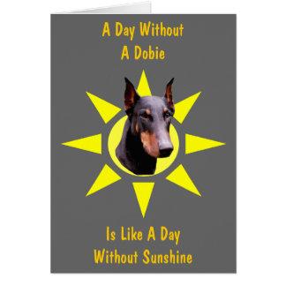 Día sin la tarjeta linda del Doberman de Dobie