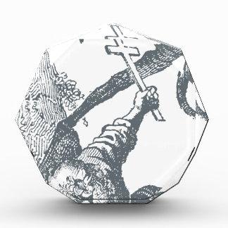 Diablo del tho de St Anthony que lucha con la cruz