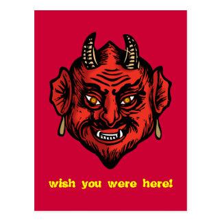 Diablo rojo de Fanged con la postal de los cuernos