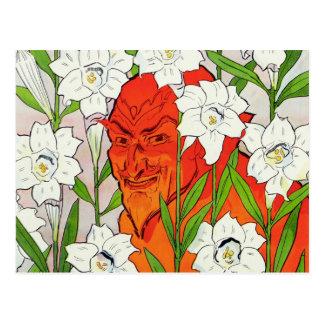 Diablo rojo que oculta entre los lirios de pascua  postal