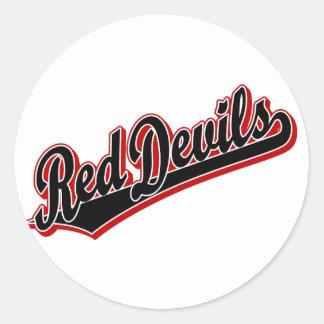 Diablos rojos en negro y rojo pegatina redonda