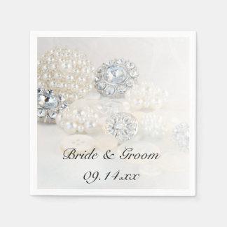 Diamante y el casarse blanco de los botones de la servilleta desechable