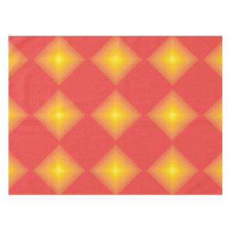 Diamantes amarillos que brillan intensamente en mantel de tela