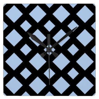 Diamantes azules claros en negro reloj cuadrado