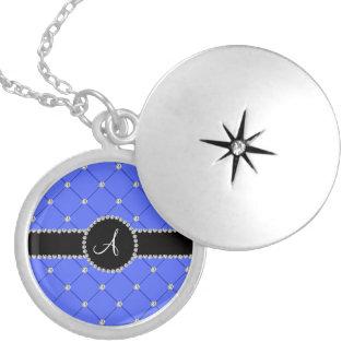 Diamantes azules del penacho del monograma medallones