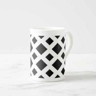 Diamantes negros en blanco taza de china
