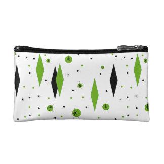 Diamantes y bolso verdes retros del cosmético de