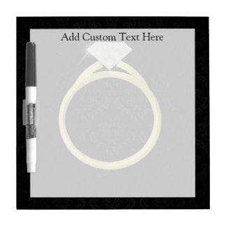 Diamond Ring on Black Dry-Erase Board