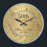 "Diamonds And Gold 50th Wedding Anniversary Large Clock<br><div class=""desc"">Elegant gold tones floral border with 2 hearts and a diamond,  Gold 50th Wedding Anniversary . It comes in silver tones for 25th anniversary.</div>"
