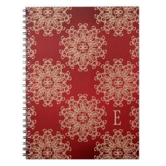 Diario con monograma del cuaderno del rojo y del o