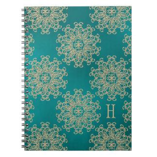 Diario con monograma del cuaderno del trullo y del