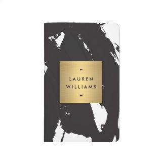 Diario negro abstracto del logotipo del nombre del cuaderno
