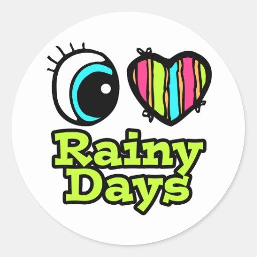 Días lluviosos del ojo del amor brillante del pegatina redonda