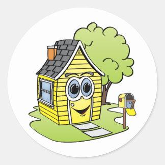 Dibujo animado amarillo de la casa pegatina redonda