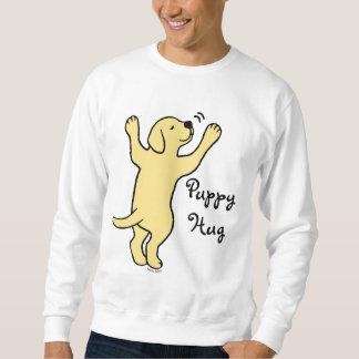 Dibujo animado amarillo del abrazo del perrito de sudaderas encapuchadas