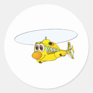 Dibujo animado amarillo del helicóptero pegatina redonda
