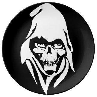 Dibujo animado blanco gótico del segador (fondo ne plato de cerámica