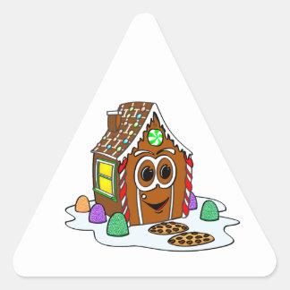 Dibujo animado de la casa del pan del jengibre pegatina triangular