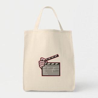 Dibujo animado de la mano de la tablilla de la bolsa de mano