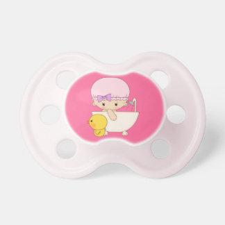 Dibujo animado de la niña en pato del caucho del j chupetes de bebé
