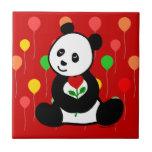 Dibujo animado de la panda y una flor del corazón teja