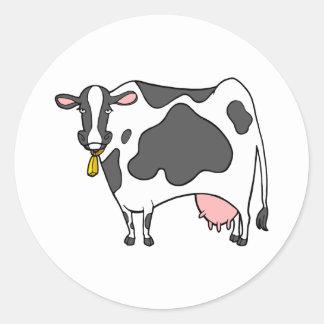 Dibujo animado de la vaca lechera etiqueta redonda
