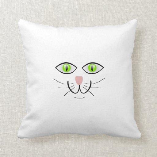 Dibujo animado de ojos verdes de la cara del gato almohadas