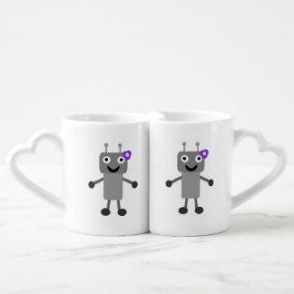 Dibujo animado del chica del robot tazas amorosas
