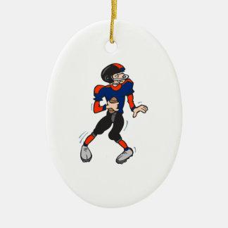 dibujo animado del futbolista del estratega adorno navideño ovalado de cerámica